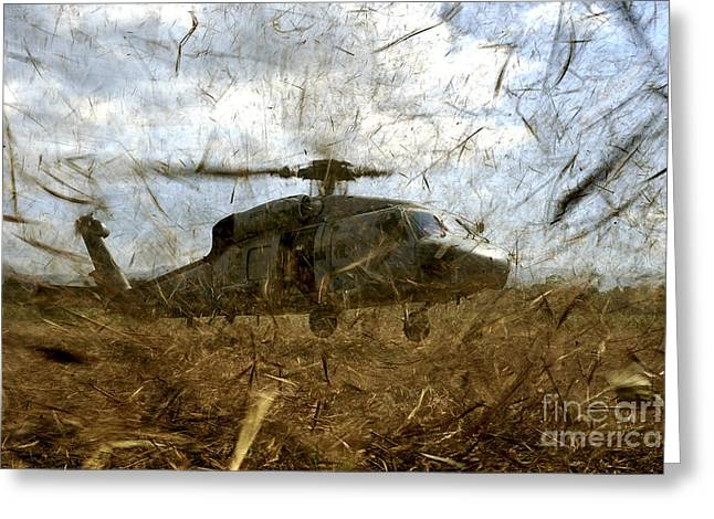 Rotary Wing Aircraft Photographs Greeting Cards - A U.s. Navy Hh-60 Seahawk Stirs Greeting Card by Stocktrek Images