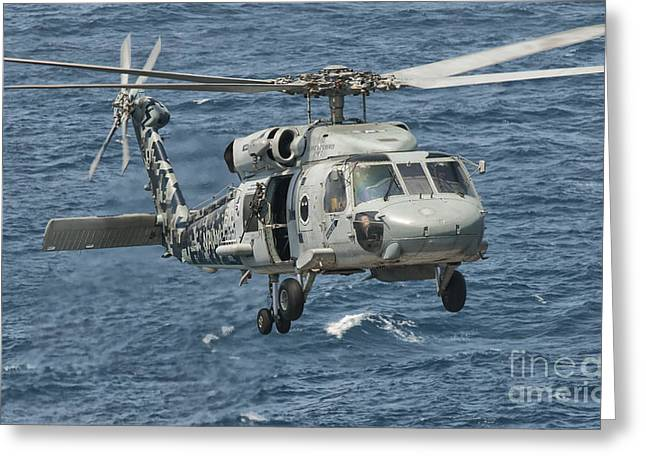 Arabian Sea Greeting Cards - A Us Navy Sh-60f Seahawk Flying Greeting Card by Giovanni Colla