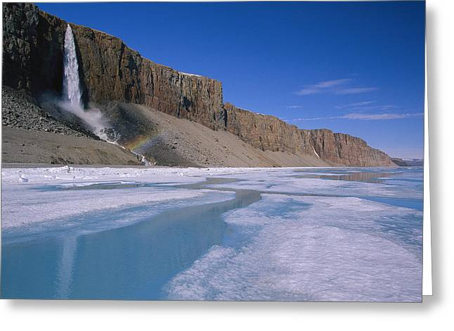 Cliffs And Water Greeting Cards - A Waterfall Tumbles Over Barren Cliffs Greeting Card by Paul Nicklen