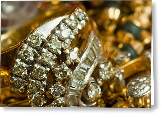 Diamond Bracelet Photographs Greeting Cards - A white gold bracelet among other yellow gold jewellery Greeting Card by Ashish Agarwal