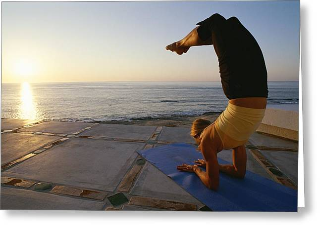 Jogging Greeting Cards - A Woman Does Yoga Facing The Rising Sun Greeting Card by Jimmy Chin