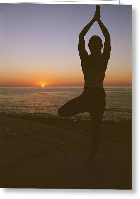 Jogging Greeting Cards - A Woman Doing Yoga At Sunrise Greeting Card by Jimmy Chin