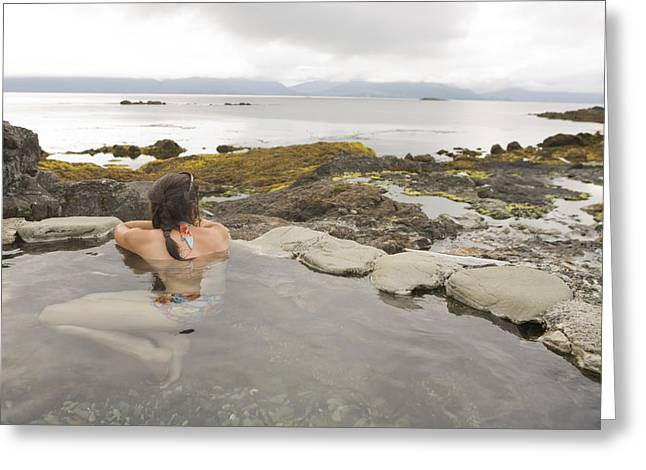 Charlotte Greeting Cards - A Woman Enjoys A Hot Spring Greeting Card by Taylor S. Kennedy
