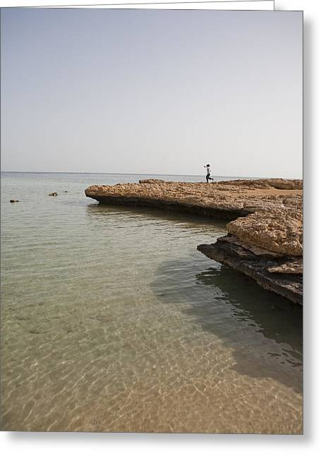 25-30 Years Greeting Cards - A Woman Hops Along The Rocky Shoreline Greeting Card by Taylor S. Kennedy