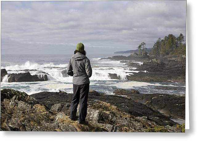 Port Renfrew Greeting Cards - A Woman Stands On A Rocky Outcropping Greeting Card by Taylor S. Kennedy