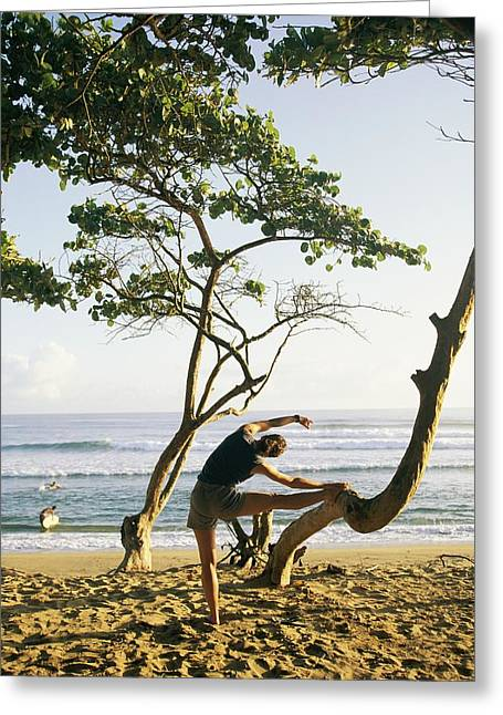 Jogging Greeting Cards - A Woman Stretches On A Beach Greeting Card by Skip Brown
