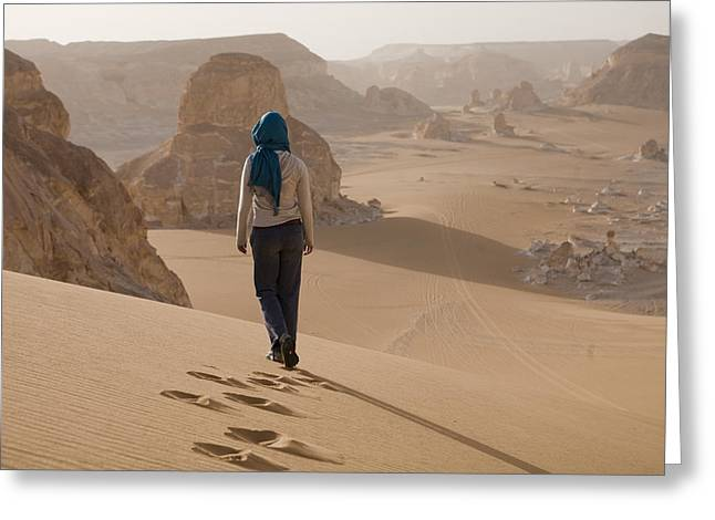 25-30 Years Greeting Cards - A Woman Walks Along A Dune Greeting Card by Taylor S. Kennedy