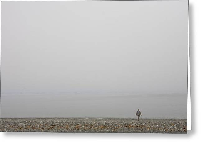 A Woman Walks Along The Beach Greeting Card by Taylor S. Kennedy