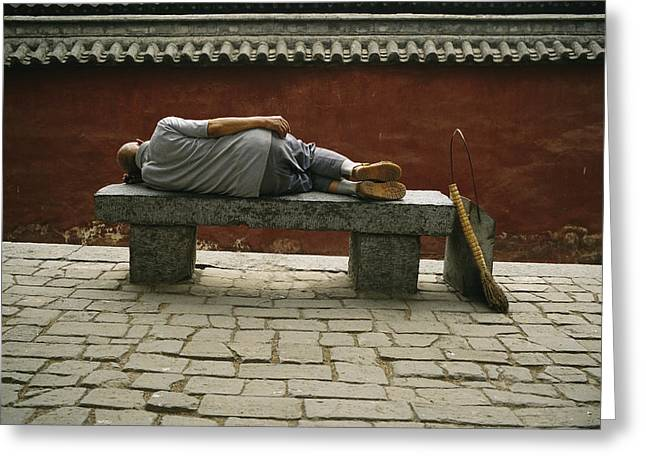 Benches And Chairs Greeting Cards - A Worker Sleeps On A Stone Bench Greeting Card by Justin Guariglia