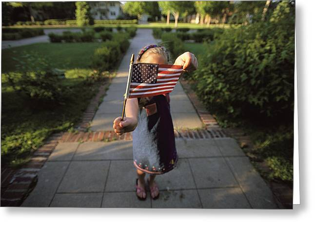 National Children Greeting Cards - A Young Girl Holds Up The Flag Greeting Card by Joel Sartore