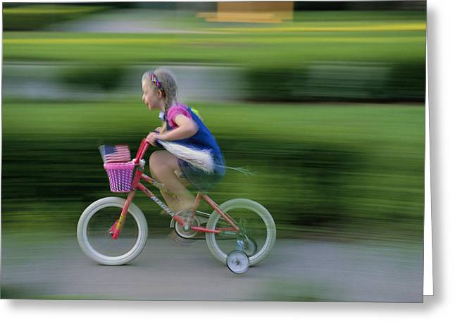 National Children Greeting Cards - A Young Girl Speeds By On Her Bicycle Greeting Card by Joel Sartore