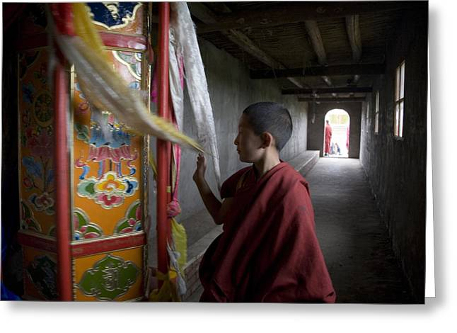 Chinese Architecture And Art Greeting Cards - A Young Monk Spinning A Prayer Wheel Greeting Card by David Evans