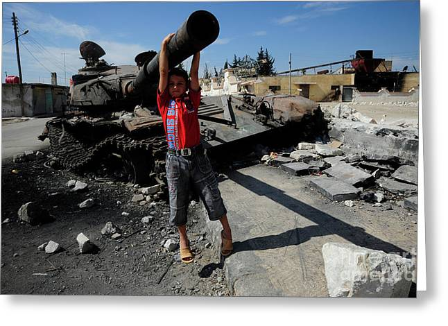 Intervention Greeting Cards - A Young Syrian Boy Plays On The Turret Greeting Card by Andrew Chittock