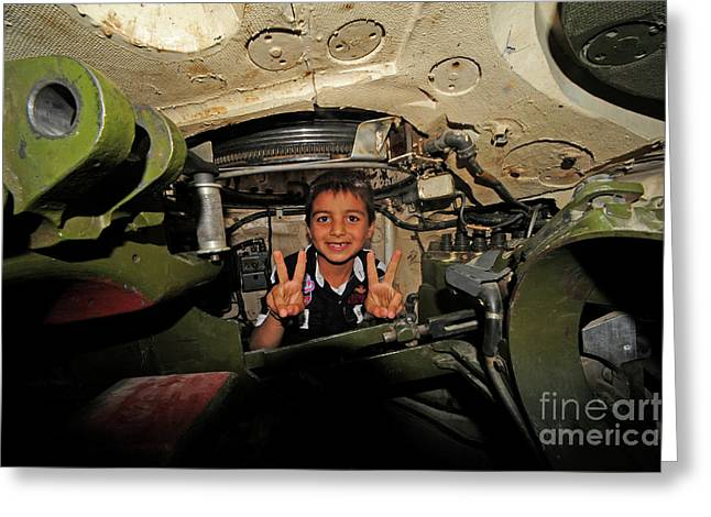 Free Of Peace Greeting Cards - A Young Syrian Boy Sitting Greeting Card by Andrew Chittock