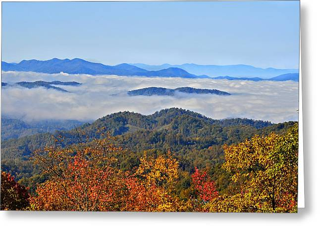 Above The Clouds Greeting Card by Susan Leggett