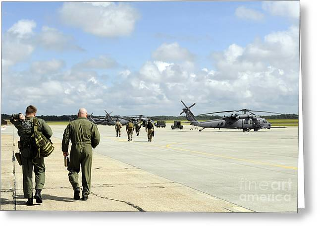 Aircrew Greeting Cards - Aircrews Prepare To Depart To Provide Greeting Card by Stocktrek Images