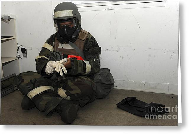 Safety Gear Greeting Cards - Airman Dons His Chemical Warfare Greeting Card by Stocktrek Images