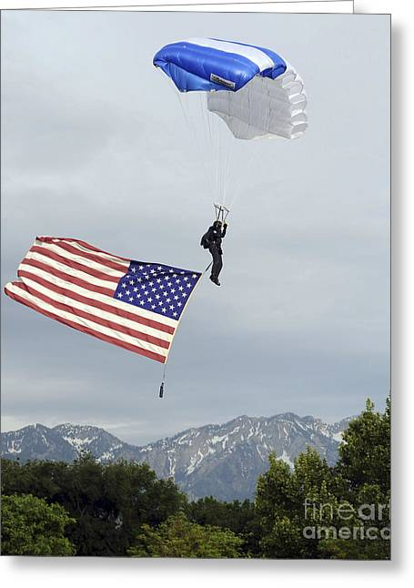 American Airmen Greeting Cards - Airman Floats Through The Sky Carrying Greeting Card by Stocktrek Images