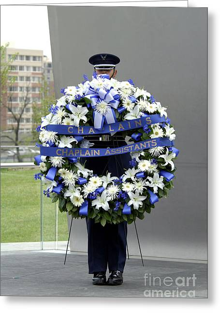 Chaplain Greeting Cards - Airman Holds A Wreath During A Ceremony Greeting Card by Stocktrek Images