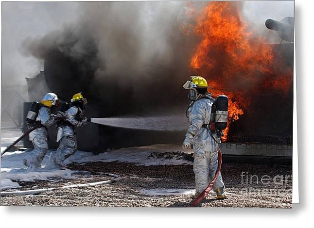 Oxygen Tank Greeting Cards - Airman Looks On As Fellow Firefighters Greeting Card by Stocktrek Images