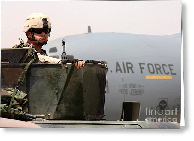 Baghdad Greeting Cards - Airman Mans The Turret Atop A Humvee Greeting Card by Stocktrek Images