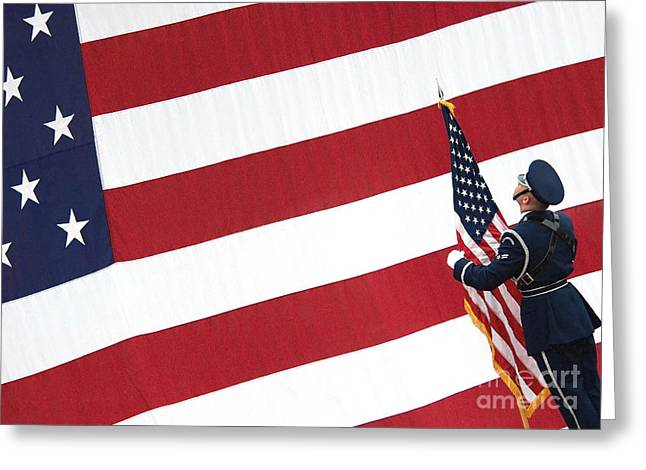 American Airmen Greeting Cards - Airman Posts The American Flag Greeting Card by Stocktrek Images