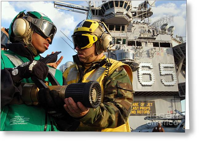 Enterprise Greeting Cards - Airman Receives Proper Fire Fighting Greeting Card by Stocktrek Images