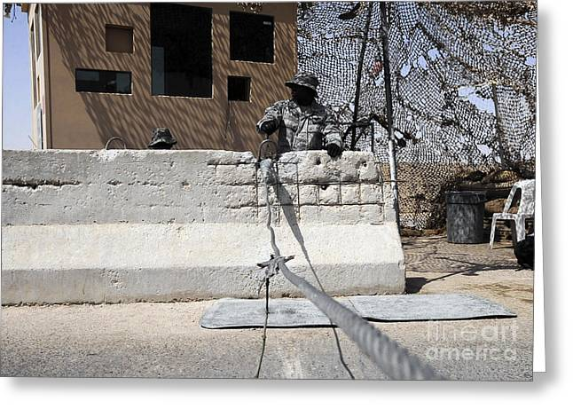 Iraq Greeting Cards - Airman Stands Post To The Entry Control Greeting Card by Stocktrek Images