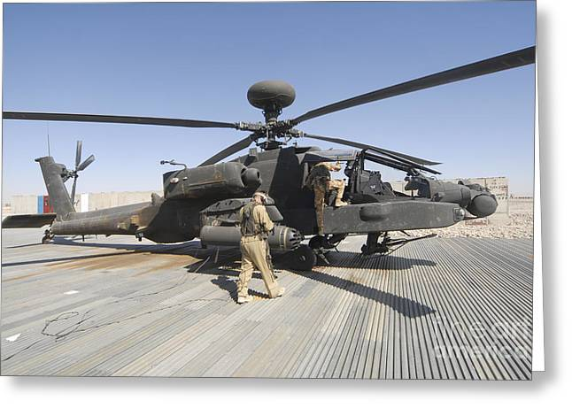 Foreign Military Greeting Cards - Airmen Board An Apache Helicopter Greeting Card by Andrew Chittock