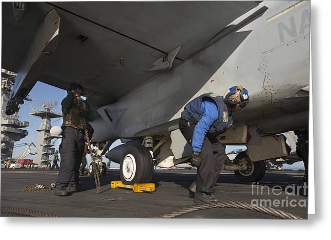 F-18 Greeting Cards - Airmen Chain Down An Fa-18e Super Greeting Card by Gert Kromhout