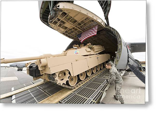 Battle Tanks Greeting Cards - Airmen Load A Tank Into A C-5m Super Greeting Card by Stocktrek Images