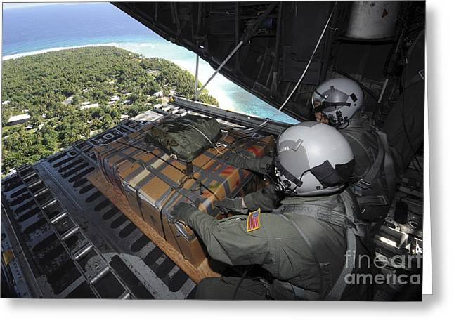 Mariana Greeting Cards - Airmen Push Out A Pallet Of Donated Greeting Card by Stocktrek Images