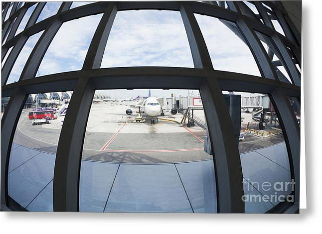 Airplane Parked At Gate Greeting Card by Don Mason