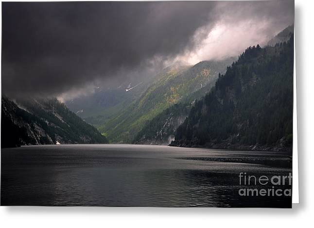 Grey Clouds Greeting Cards - Alpine lake with sunlight Greeting Card by Mats Silvan