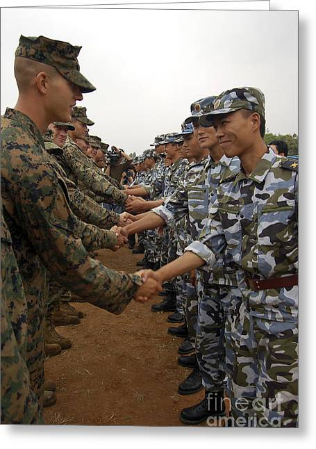 Shaking Hands Greeting Cards - American And Chinese Marines Shake Greeting Card by Stocktrek Images