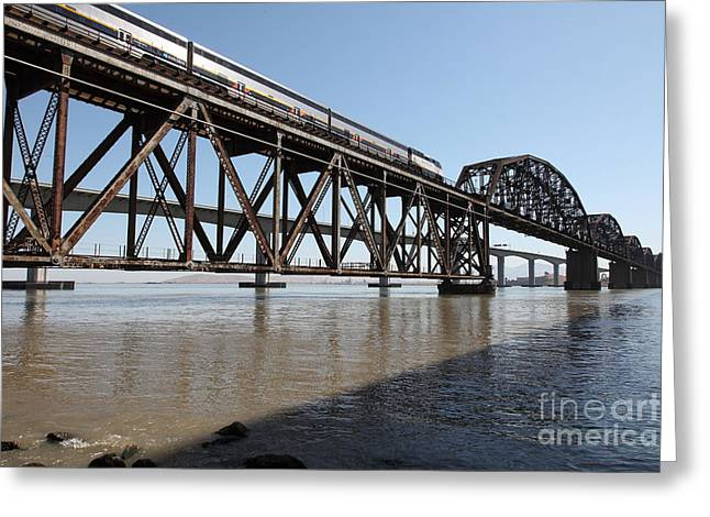 Carquinez Straits Greeting Cards - Amtrak Train Riding Atop The Benicia-Martinez Train Bridge in California - 5D18829 Greeting Card by Wingsdomain Art and Photography