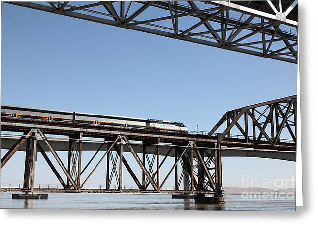 Carquinez Straits Greeting Cards - Amtrak Train Riding Atop The Benicia-Martinez Train Bridge in California - 5D18837 Greeting Card by Wingsdomain Art and Photography