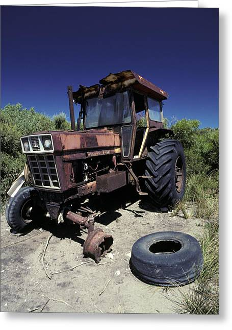 An Abandoned Tractor Rusts Away Greeting Card by Jason Edwards