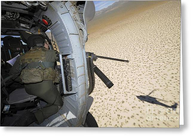 .50 Caliber Greeting Cards - An Aerial Gunner Scans Terrain Greeting Card by Stocktrek Images