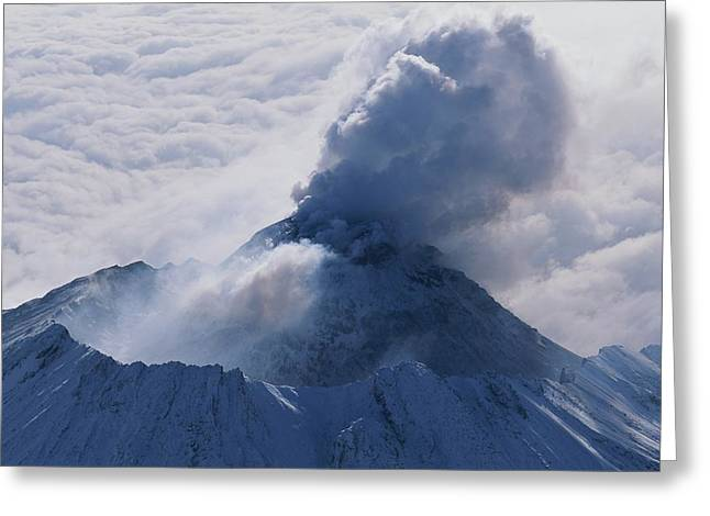 Volcanoes And Volcanic Action Greeting Cards - An Aerial View Of Smoke Pouring Greeting Card by Carsten Peter