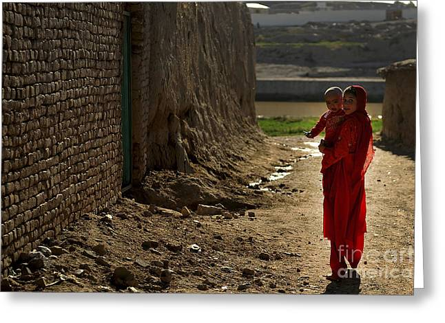 Qalat Greeting Cards - An Afghan Girl Carries Her Little Greeting Card by Stocktrek Images