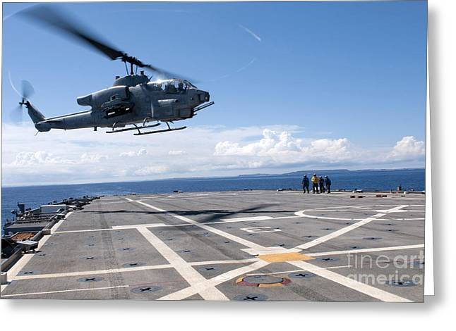 Flight Operations Photographs Greeting Cards - An Ah-1w Super Cobra Helicopter Lands Greeting Card by Stocktrek Images