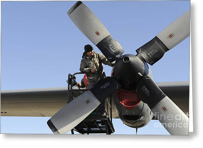 C-130 Hercules Greeting Cards - An Aircraft Maintainer Troubleshoots Greeting Card by Stocktrek Images