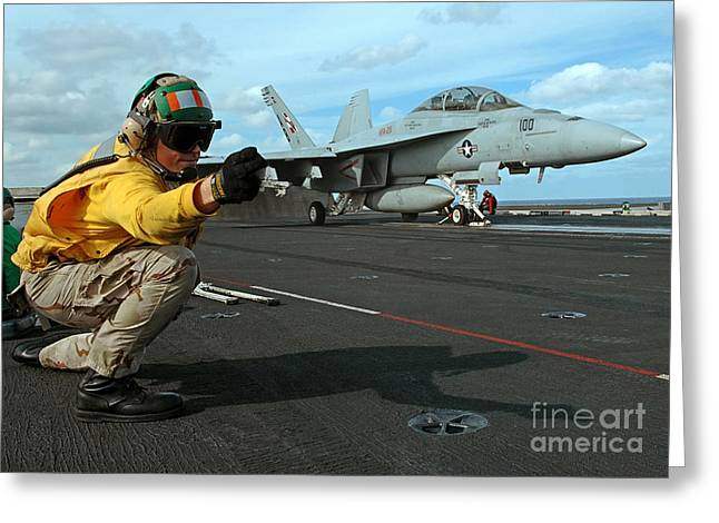 F-18 Greeting Cards - An Airman Gives The Signal To Launch An Greeting Card by Stocktrek Images
