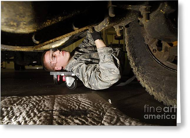 Best Sellers -  - Replacing Greeting Cards - An Airman Inspects The Undercarriage Greeting Card by Stocktrek Images