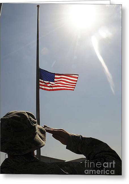 American Airmen Greeting Cards - An Airman Salutes The American Flag Greeting Card by Stocktrek Images