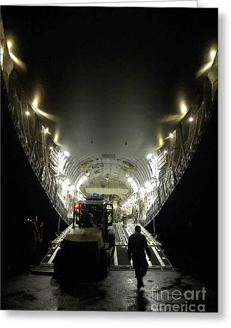 Cargo Aircraft Greeting Cards - An Airman Uses A Forklift To Load Greeting Card by Stocktrek Images