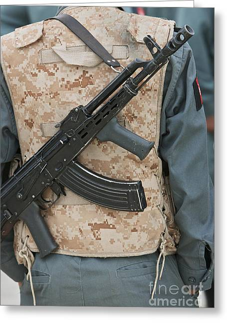 Hand In Pocket Greeting Cards - An Ak-47 Rests On The Sling Of An Greeting Card by Terry Moore