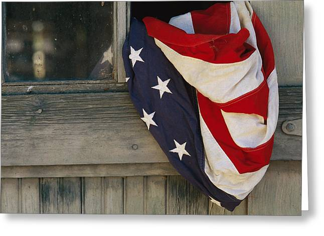 American National Flag Greeting Cards - An American Flag Draped Through An Open Greeting Card by Raul Touzon