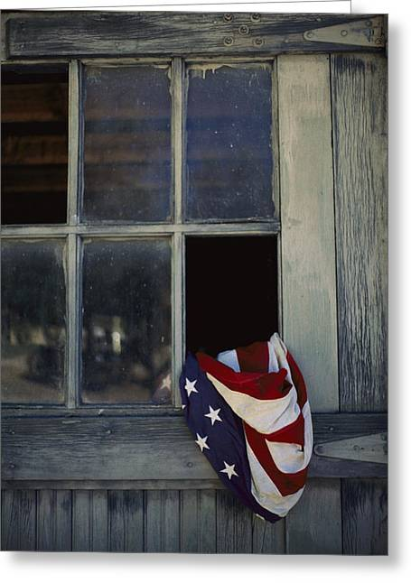 Window Of Life Greeting Cards - An American Flag Lies Loosely Bunched Greeting Card by Raul Touzon